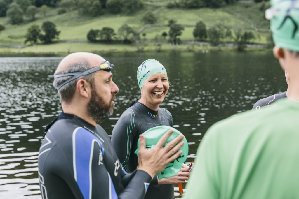 Open water swimmer smiling